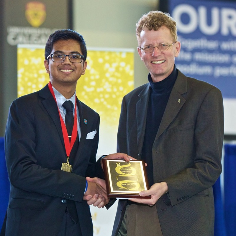 Image of Mehul Gupta, young scientist, being presented an award